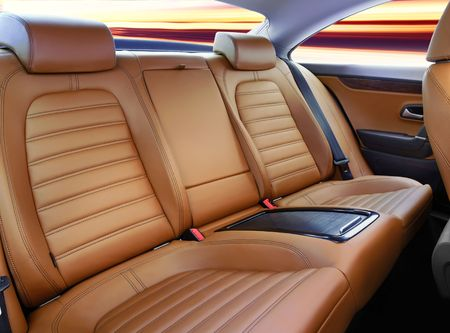 leather chair: back passenger seats in modern luxury comfortable car Stock Photo