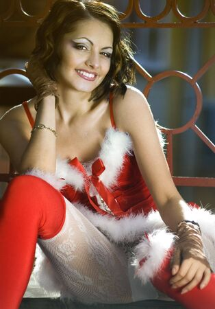 snegurochka: Portrait of beautiful happy sexy girl wearing santa claus clothes on city background