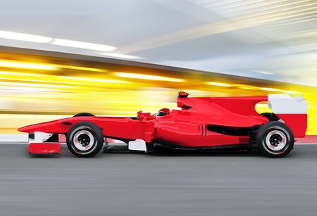 dynamic motion: formula one race red car on speed track - motion blur