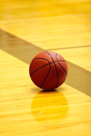 concurrence: orange basket ball on yellow court at break time Stock Photo
