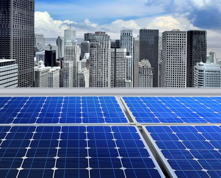 energy generation: solar panels on the roof of modern skyscraper Stock Photo