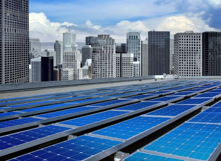 solar roof: solar panels on the roof of modern skyscraper Stock Photo