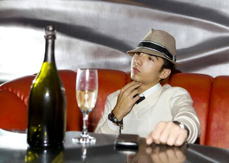 fop: Attractive young gangster drinking in cocktail party at cabaret