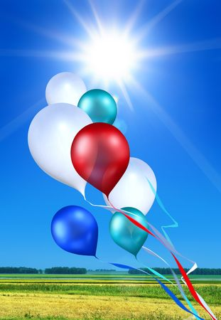 whiff: toy balloons soaring in the blue sky under shining sun Stock Photo