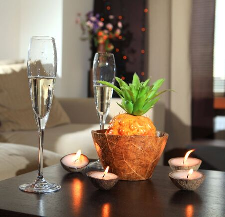 Romantic still-life with wine glasses for champagne and candles photo