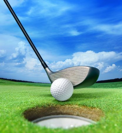 golf green: golf ball on lip near bunker, lovely beautiful golf course Stock Photo