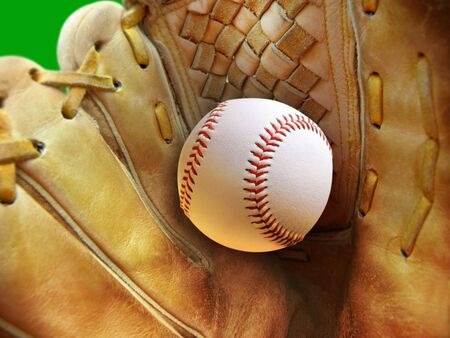 Leather glove with baseball. Close-up with shallow dof. Focus on seams of ball.  photo