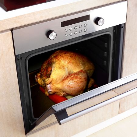 christmas cooking: appetizing roast turkey in the oven for thanksgiving day