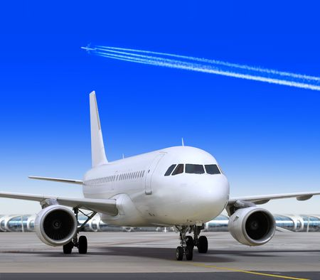 parked: big passenger airplane is landing to runway of airport