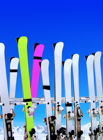 snow ski: skis on snow covered place in winter with mountains in the distance Stock Photo