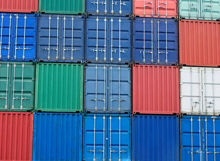 consignment: background of multi-colored freight shipping containers at the docks