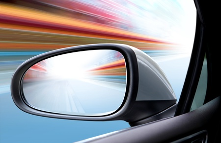 speed car driving at high speed on empty road - motion blur photo