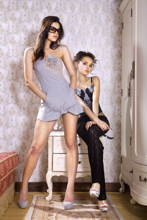 young beautiful fashion women try on new clothes photo