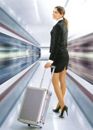 Business traveler with luggage and speed train on station Banco de Imagens
