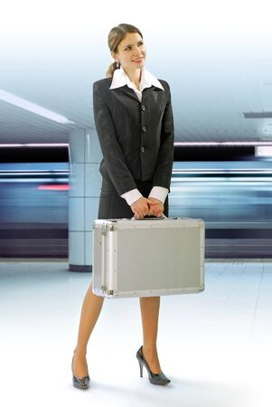 Business traveler with luggage and speed train on station photo