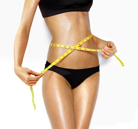 cintas metricas: mujer medir de forma perfecta del concepto de estilos de vida saludables de muslo hermosa Foto de archivo