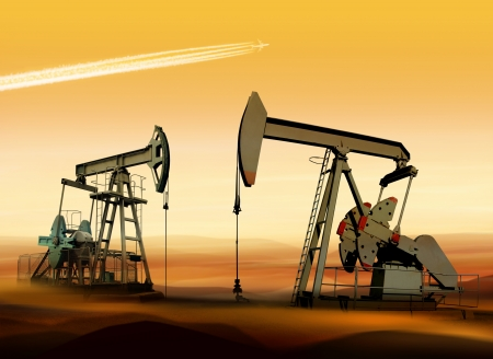 Working oil pumps in desert place of Middle East Stock Photo