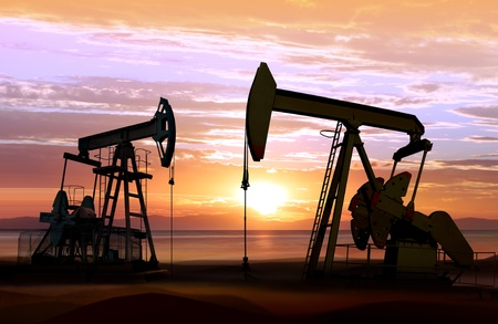 silhouette of working oil pumps on sunset background Standard-Bild