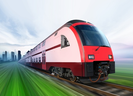 super streamlined train with motion blur moves from city 写真素材
