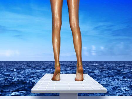 springboard: hermosas piernas de mujer en blanco springboard, resort Foto de archivo