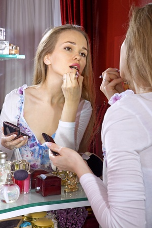 beautiful woman in front of mirror in dressing room photo