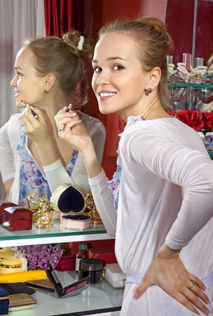 dressing room: beautiful woman in front of mirror in dressing room
