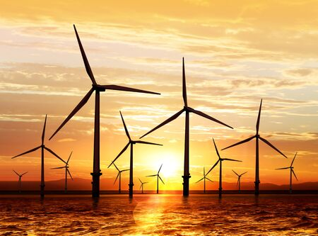wind turbine: silhouette of wind turbine generating electricity on sunset Stock Photo