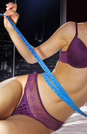 woman measuring perfect shape of beautiful thigh healthy lifestyles concept photo