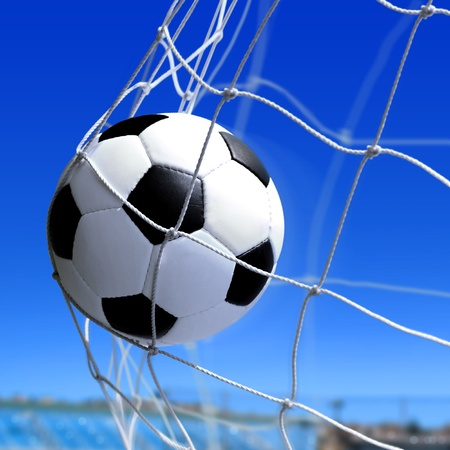 leather soccer ball flies into the net gate Stock Photo - 9587398