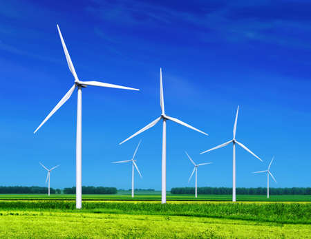 wind power plant: green meadow with Wind turbines generating electricity