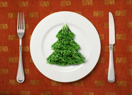 christmas dish: The Christmas salad on white plate on table
