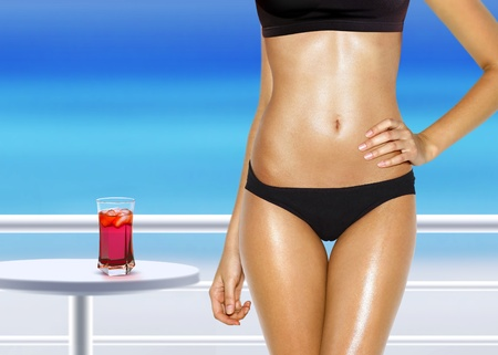 part of woman with red cocktail near swimming pool Standard-Bild