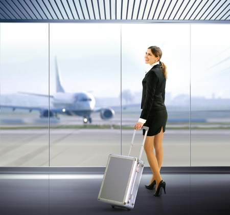 stewardess: Business traveler with luggage in airport Stock Photo