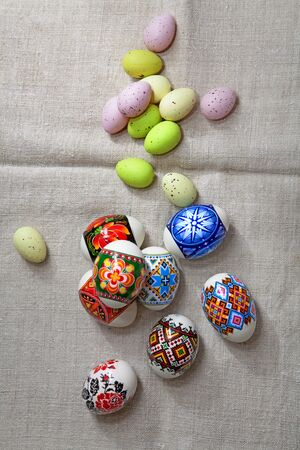 Painted Colorful Easter Eggs on linen fabric photo