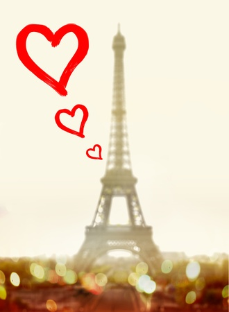 lovebirds: hearts in front of famous Eiffel Tower in Paris
