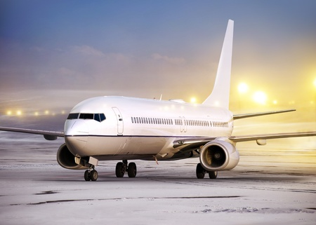 airport and white plane at non-flying weather, winter time