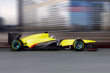 formula one: formula one car driving at high speed on empty road - motion blur