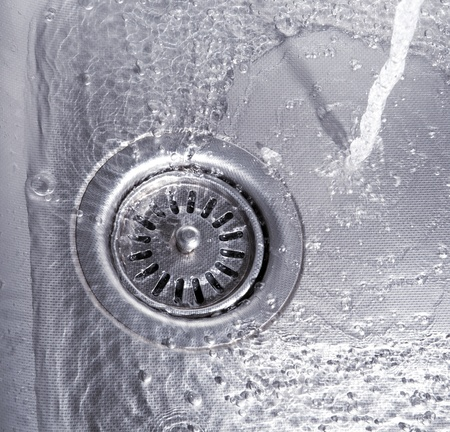 Close-up of kitchen sink with water drops  photo