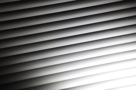 Repetitive patterns of a window blinds, texture background photo