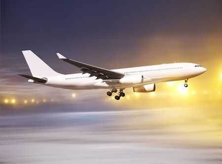 white plane taking off at non-flying weather, blowing snow