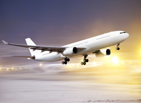 airport and white plane taking off at non-flying weather, snowstorm
