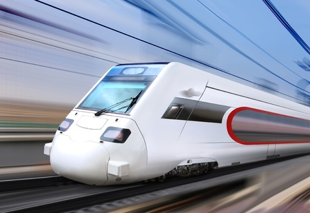 white super streamlined train with motion blur moves on railroad 報道画像