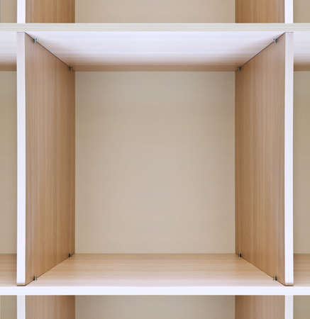 forepart: empty wooden shelves in department store