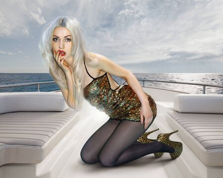 private party: Young attractive blonde woman in shining dress on deck of yacht Stock Photo