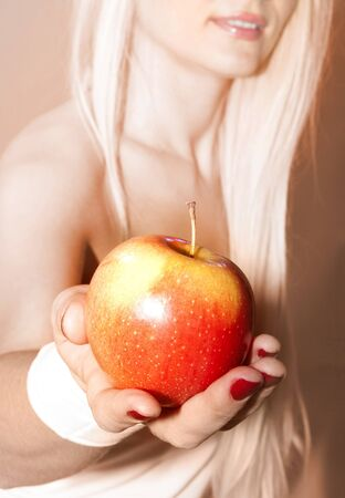 suggests: close up of female hand that suggests to take apple