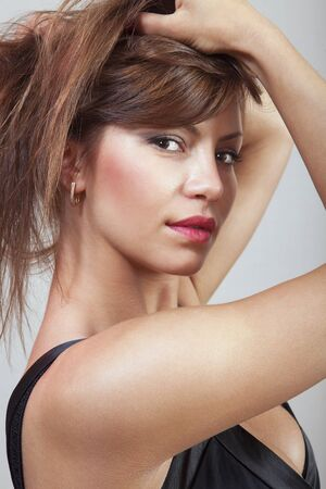 beautiful woman looks with the dishevelled hair-do Stock Photo - 13649724