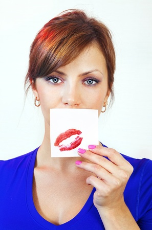 beautiful female android holds leaf with lipstick kiss photo