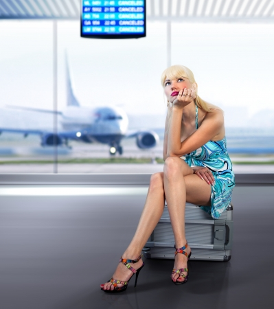 beautifu traveler misses with luggage in airport photo