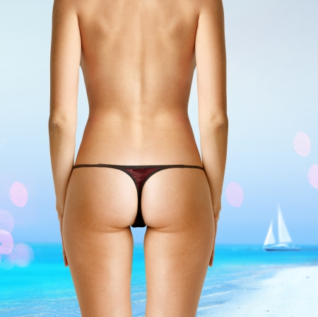 back of woman in bikini on beach photo