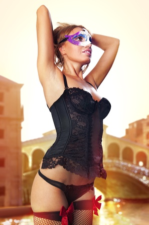 sexual beautiful girl in carnival dress at sunrise of Venice Stock Photo - 14074004